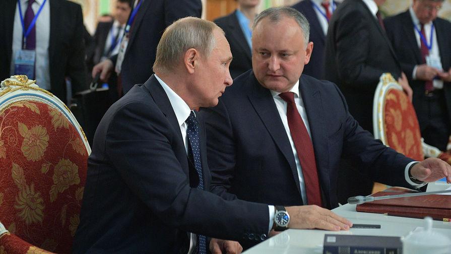 Путин поддержал Додона