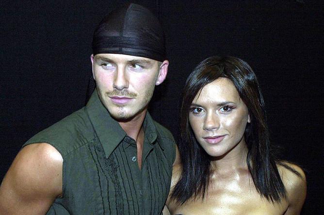Футболист Дэвид Бекхэм с супругой поп-звездой Викторией Бекхэм. 2000 год