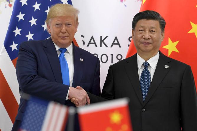 Президент США Дональд Трамп и председатель Китайской Народной Республики (КНР) Си Цзиньпин во время встречи на полях саммита G20, 29 июня 2019 года