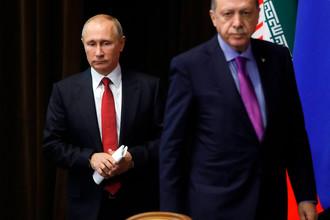 Президент России Владимир Путин и президент Турции Реджеп Тайип Эрдоган перед пресс-конференцией в Сочи, 22 ноября 2017 года