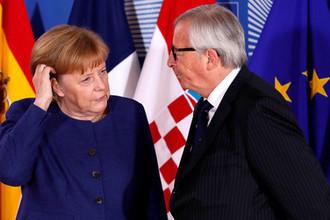 Канцлер ФРГ Ангела Меркель и председатель Еврокомиссии Жан-Клод Юнкер во время встречи лидеров ЕС в Брюсселе, 24 июня 2018 года