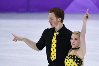 Российские фигуристы Евгения Тарасова и Владимир Морозов во время произвольной программы парного катания на Олимпийских играх — 2018