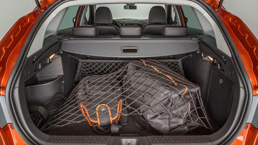 Объем багажного отделения, если учитывать нишу в арке правого колеса, и двойной пол, составляет 480...