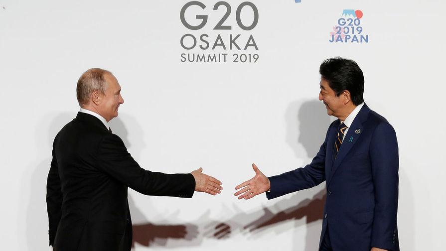 Путин и Абэ обсудят заключение мирного договора