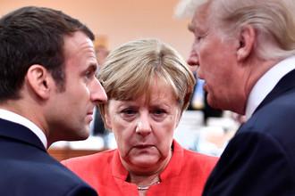 Французский президент Эммануэль Макрон, канцелер ФРГ Ангела Меркель и президент США Дональд Трамп на саммите G20 в Гамбурге, июль 2017 года