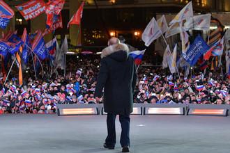 Президент России Владимир Путин на митинге-концерте на Манежной площади «Россия. Севастополь. Крым» к четвертой годовщине воссоединения Крыма с Россией, 18 марта 2018 года
