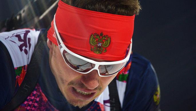 Евгений Устюгов на финише спринтерской гонки в соревнованиях по биатлону среди мужчин на Олимпиаде в Сочи, февраль 2014 года