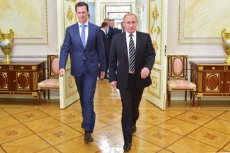 Президент России Владимир Путин и президент Сирии Башар Асад во время встречи в Кремле, 20 октября 2015 года