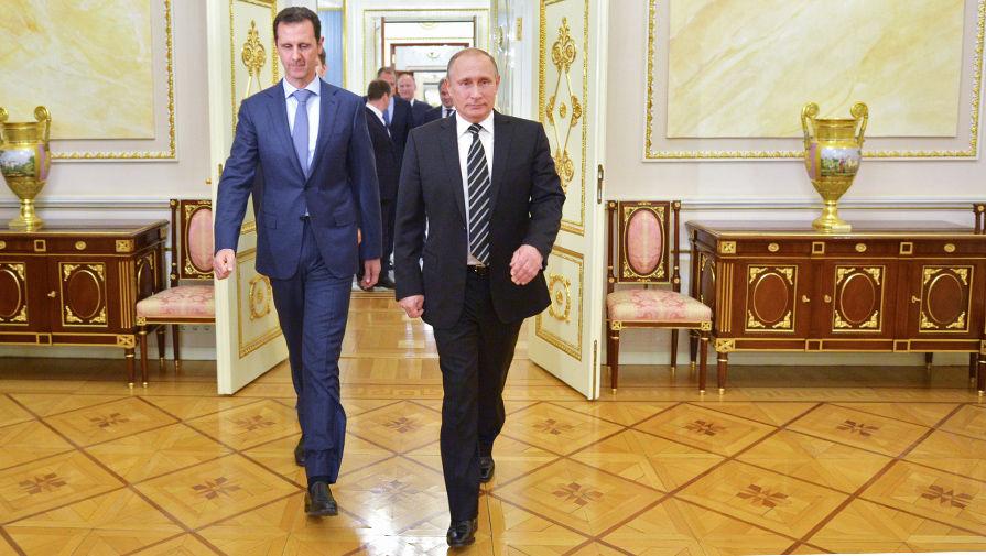 Президент России Владимир Путин и президент Сирии Башар Асад во время встречи в Кремле, 20 октября...