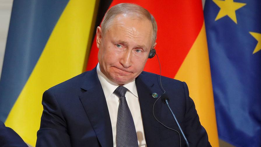 Президент России Владимир Путин во время пресс-конференции по итогам саммита «нормандского формата» в Елисейском дворце, 10 декабря 2019 года