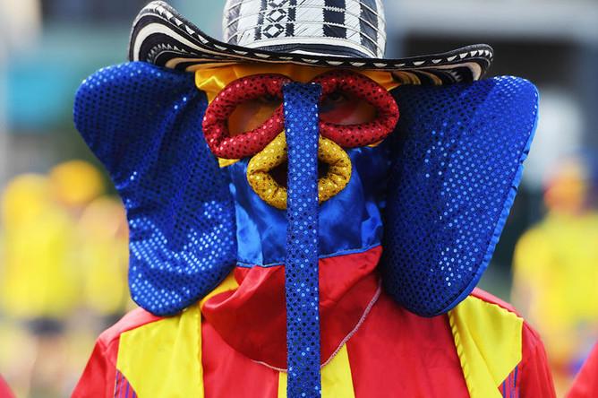 Болельщик перед матчем чемпионата мира по футболу между сборными Колумбии и Польши